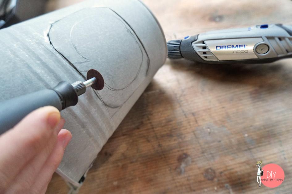 Mit der Metalltrennscheibe den Eimer aufsägen für das Dekolicht