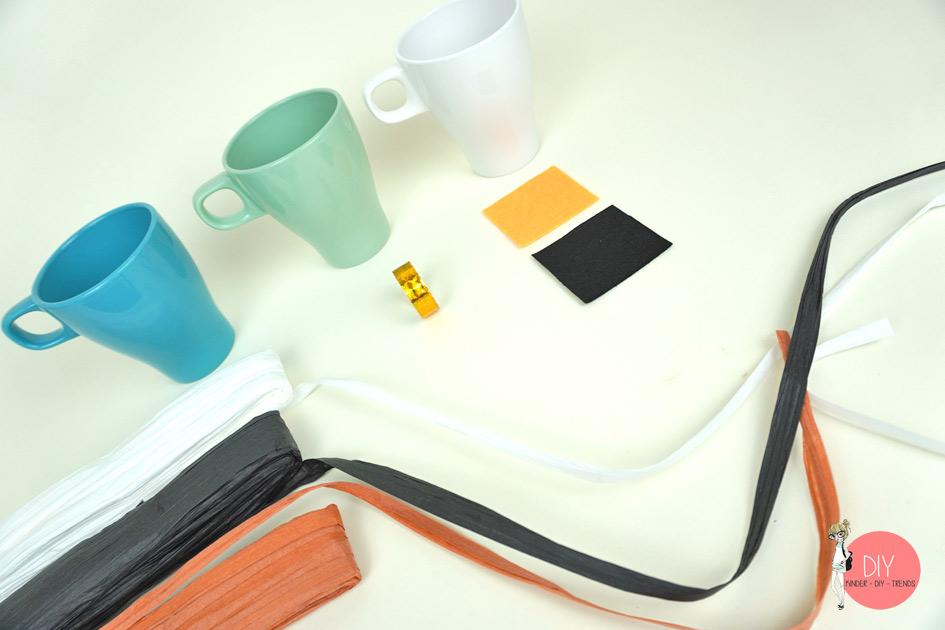 Material für die Bastelidee Geschenkverpackung Tasse als Schneemann, Engel und Nikolaus dekorieren